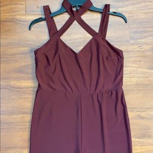 Burgundy jumpsuit. 94% Polyester 6% Spandex